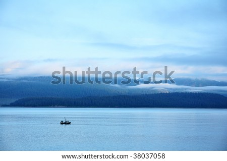 Fishing Boat with Mountains and Low Clouds, Glacier Bay National Park, Alaska