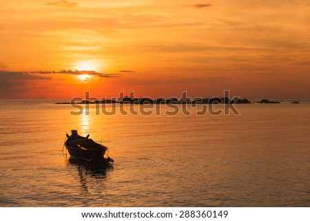 Fishing boat  with sunset scene in koh phangan, Surat Thani, Thailand : selective focus on boat. - stock photo
