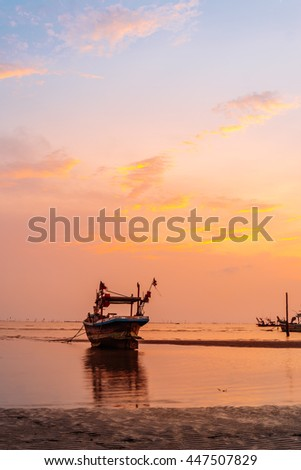 fishing boat with sunset time.