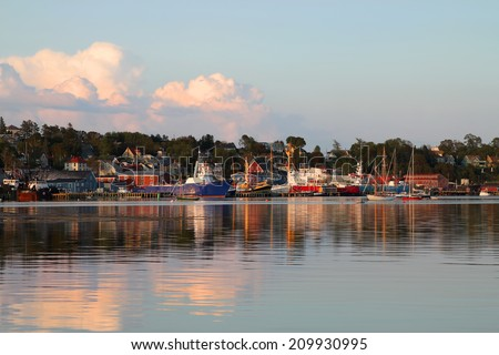 Fishing boats along the  harbor front of Lunenburg, Nova Scotia, one of the Maritime Provinces , Canada a UNESCO world heritage site.  - stock photo