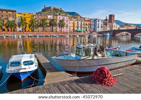 Fishing boats and nets on the river in Bosa in Sardinia, Italy - stock photo