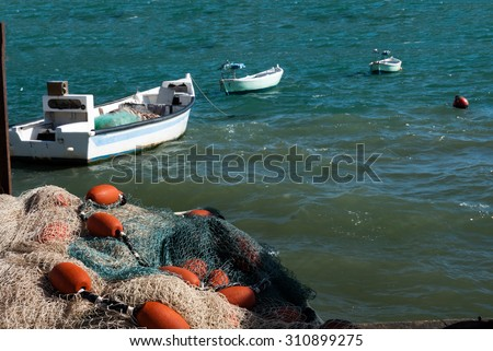 Fishing boats at anchor waiting for loading nets to go fishing - stock photo