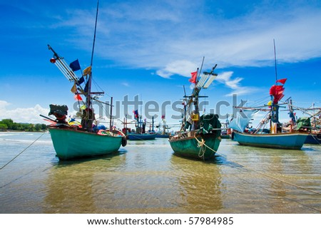Fishing boats at cha-am beach in Thailand - stock photo