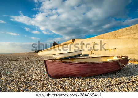 Fishing boats at Chesil Cove on the eastern edge of Chesil Beach in Portland, Dorset - stock photo