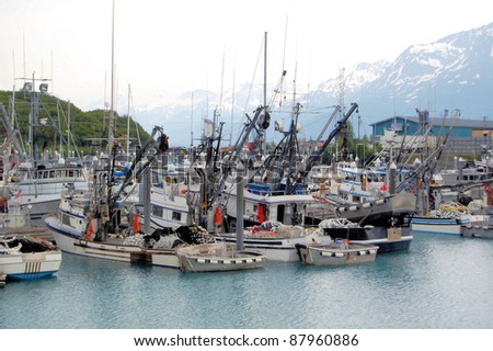 Fishing Boats at Dock in Valdez Harbor in a Cloudy Day, Alaska - stock photo