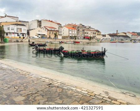 Fishing boats at great high tide on Chufre port in Arousa Island