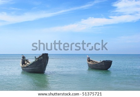Fishing boats at the shore of the Saint Martins island of Bangladesh - stock photo