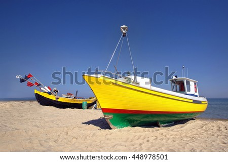 Fishing boats by the sea