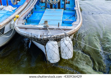 Fishing boats dock after low tide. - stock photo