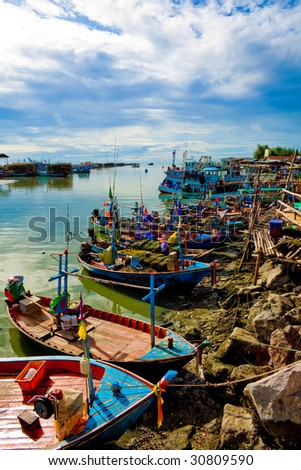 Fishing Boats docking in the morning. - stock photo