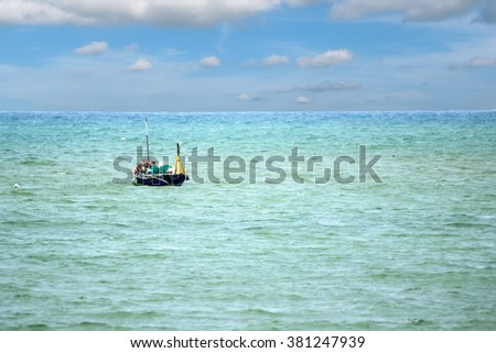 Fishing boats floating in the sea.