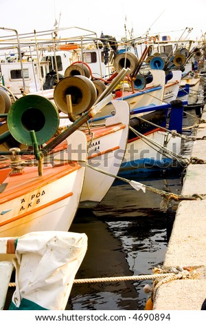 fishing boats in a harbour.