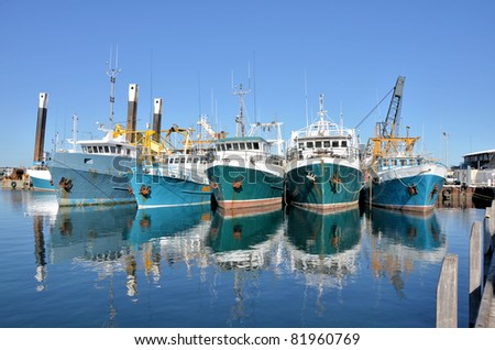 Fishing Boats in a Harbour and a Blue Sky - stock photo