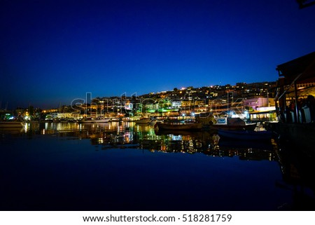Fishing boats in a port in Athens after sunset