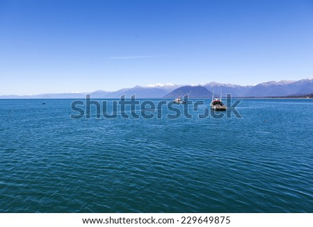 fishing boats in New Zealand South Island - stock photo
