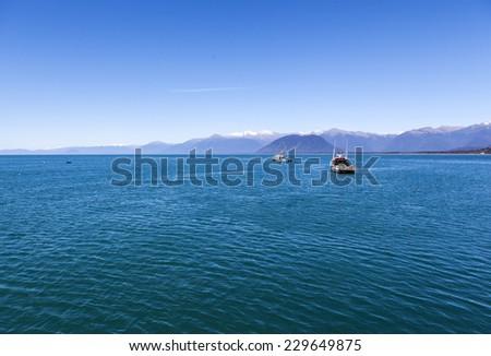 fishing boats in New Zealand South Island - stock photo