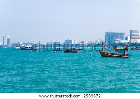 fishing boats in pattaya - stock photo
