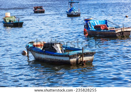 fishing boats in the bay ocean - stock photo