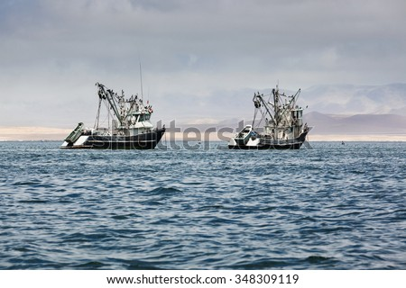 fishing boats in the bay of the Pacific Ocean - stock photo