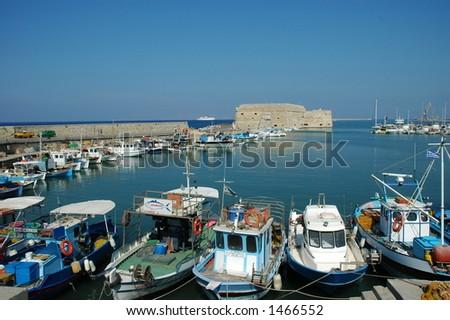 Fishing boats in the harbor of Heraklion, Crete - stock photo