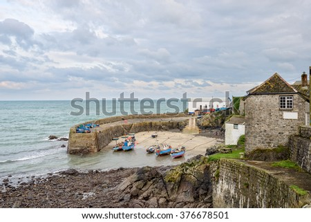 Fishing boats in the harbour at Coverack on the Lizard Peninsula in Cornwall - stock photo