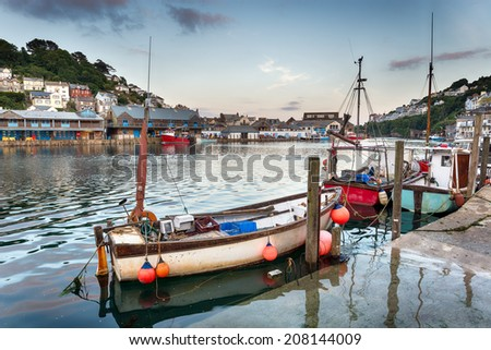 Fishing boats in the harbour at Looe on the south coast of cornwall - stock photo