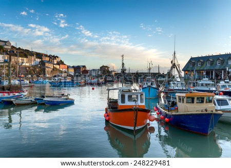 Fishing boats in the harbour at Mevagissey in Cornwall - stock photo