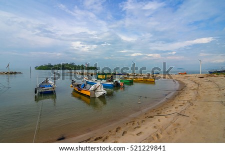Fishing boats in the harbour at Port Dickson Beach, Negeri Sembilan, Malaysia. The image may have soft, blurry and noise due to long exposure