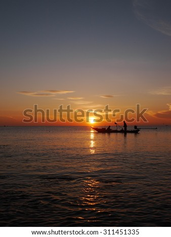 Fishing boats in the ocean silhouette