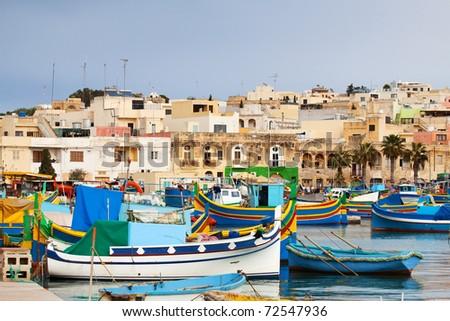 Fishing boats  lying at Marsaxlokk Bay. Malta - stock photo