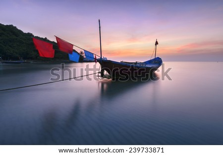 Fishing boats moored along the river - stock photo