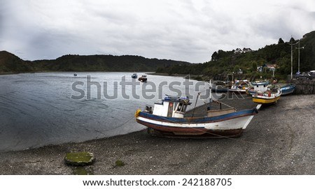 Fishing boats moored in Angelmo, tourist area and restaurant specialists in cooking fish - stock photo