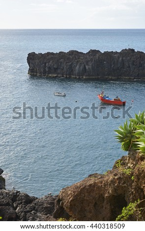 Fishing boats moored near harbour entrance at Camara de Lobos in Madeira, Portugal