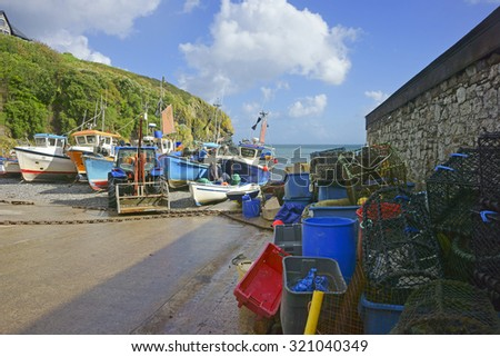 Fishing boats moored on the slipway near the beach at Cadgwith Cove on the Lizard Peninsula in Cornwall, United Kingdom - stock photo