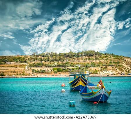 fishing boats near fishing village of Marsaxlokk (Marsascala) in Malta - stock photo