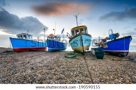 Fishing boats on a shingle beach at Beer in Devon - stock photo