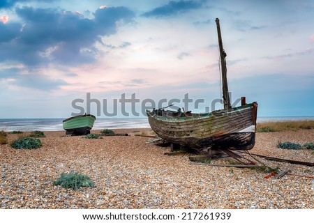 Fishing boats on a shingle beach at Lydd-on-Sea in Romney Marsh, Kent