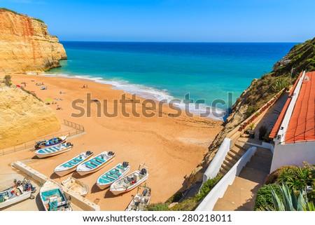 Fishing boats on sandy Benagil beach in Algarve region of Portugal - stock photo