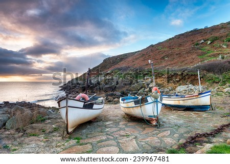 Fishing boats on the beach at Penberth Cove a small fishing village near Land's End in Cornwall - stock photo