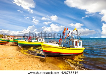 Fishing boats on the beach on a sunny day in Sopot, Poland. - stock photo