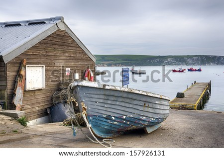 Fishing boats on the quayside at Swanage on Dorset's Jurassic coastline. - stock photo