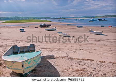 Fishing boats on the sand at low tide near Portland, Maine USA. - stock photo