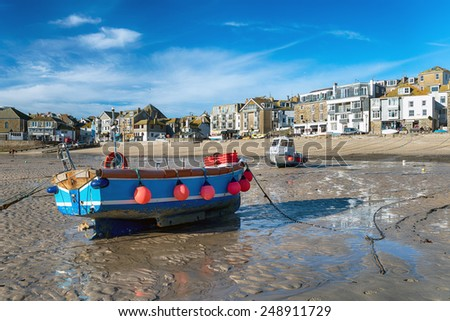 Fishing boats on the seafront at St Ives a picturesque coastal town in Cornwall - stock photo