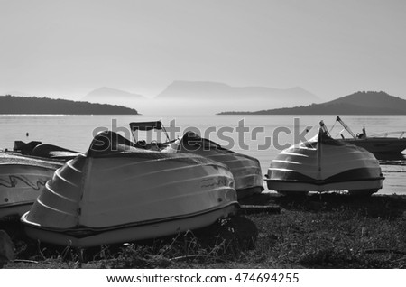 Fishing boats on the shore. Black and white photo