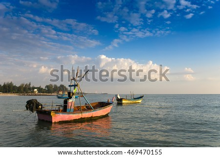 fishing boats parking in the sea