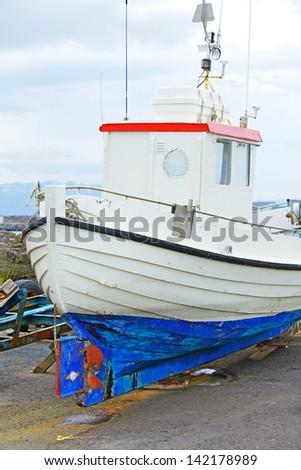 Fishing boats repair in the harbor of Husavik, Iceland - stock photo