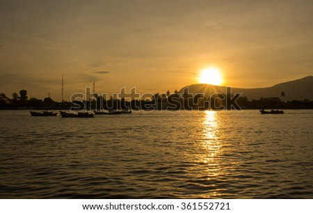Fishing boats returning with the day's catch. Kampot, Cambodia.  - stock photo