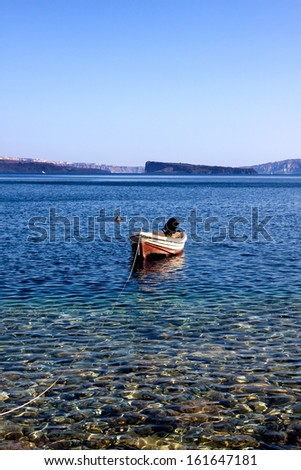 Fishing boats tied up at the beach  - stock photo
