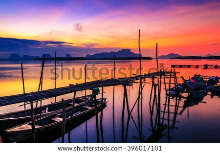 Fishing boats with morning sun on the sea.The sunset is beautiful.In Thailand. - stock photo