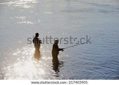 Fishing by English Bay in Vancouver - stock photo